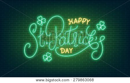 Patricks Day. Neon Glowing Lettering Sign Of Happy St. Patrick's Day Lettering And Clover Leaves