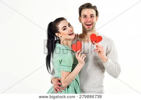 Valentines Day And Love. Man And Woman Couple In Love Hold Red Heart Card On White Background. Roman