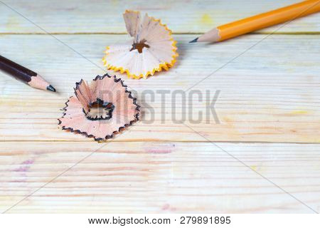 Pencil Sharpener Shavings On A Wooden Table. Back To School