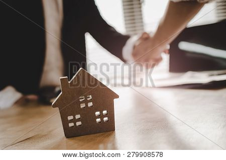 Real Estate Broker Manager Hand Shake To Customer After Signing Contract For Buying House In Estate