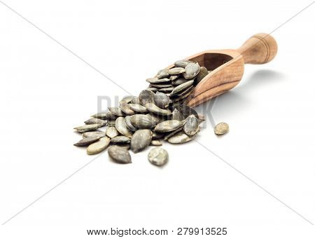 Pumpkin seeds in wooden scoop