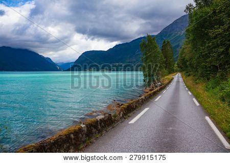 Scenic road along the Lustrafjord or Lustrafjorden fjord, branch of greater Sognefjord or Sognefjorden (the King of the Fjords), Luster municipality, Sogn og Fjordane, Norway, Scandinavia