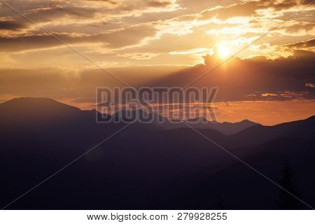 Awesome sunset in the alpine highlands. Location place Carpathian mountains, Ukraine, Europe. Magnificent summer scene in the morning light. Seasonal background. Discover the beauty of earth.