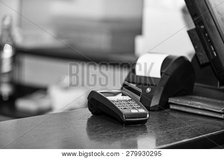 Payment With Credit Card. Red Bankcard Inserted In Edc Machine
