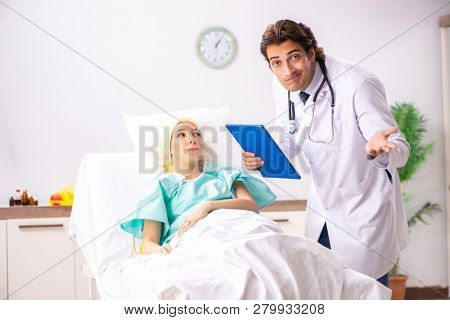 Young handsome doctor visiting female oncology patient  poster
