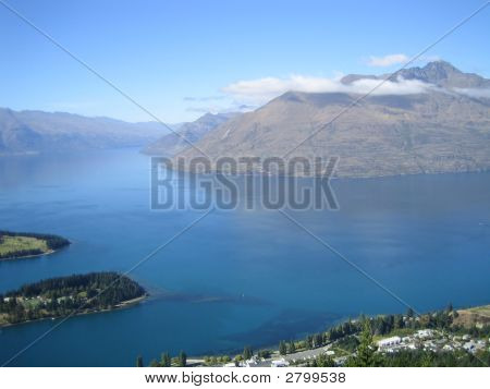 Mountain With Cloud Top And Lake