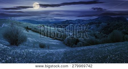 Panorama Of Countryside In Mountain At Night In Full Moon Light. Beautiful Landscape In Springtime
