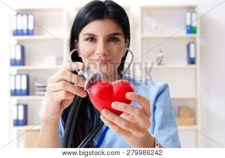 Female doctor cardiologist working in the clinic