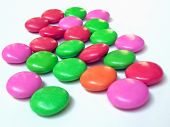 close up view of colorful candy on white poster