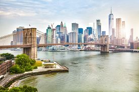Amazing View Of New York City Skyline And Brooklyn Bridge With Skyscrapers And East River Flowing Du