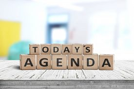 Today's Agenda Sign On A Wooden Desk