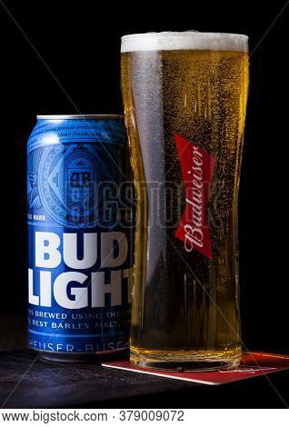 London, Uk - April 27, 2018: Aluminium Can Of Budweiser Bud Light Beer On Wooden Background With Lab