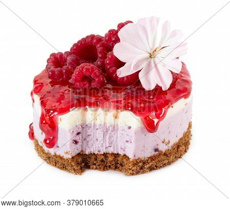 Cheesecake With Fresh Raspberries And Jam Isolated On White Background.