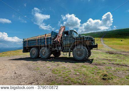 Ivano-frankovsk, Ukraine- July 27, 2019: Loaded Old Timber Truck Ural Transporting Logs In Carpathia