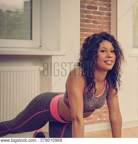 Beautiful Young Mixed Race Woman In Sportswear Doing Stretching Exercise