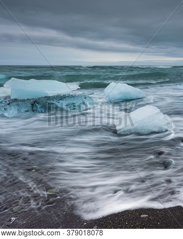View Of The Diamond Beach In The South Of Iceland. Ice Blocks From Jokulsarlon Glacier, Vatnajokull