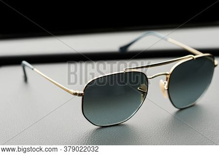 Fashionable Sunglasses. Sunglasses With Mirrored Lenses On Leather Table. Mirrored Sunglasses With A
