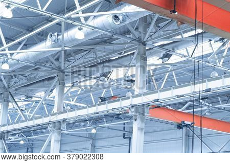 Blue Lights And Ventilation System In Long Line On Ceiling Of The  Industrial Building. Exhibition H