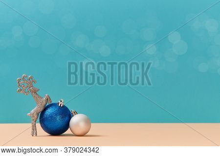 Blue And White Balls. Glitter Reindeer. New Year. Christmas Holiday Concept. Copy Space For Text. Bl