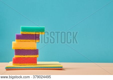 Housekeeping. Cleaning Materials. Cleanliness Concept. Stack Of Rags Isolated On Blue Background. Co