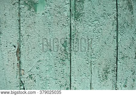 Many Layers Of Peeling Paint. Grainy Painted Green Surface, Beautiful Green Background,