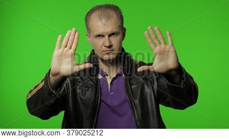 Rocker Man In Brown Leather Jacket Showing Stop Gesture With Hands. No, Never, Disliking And Rejecti