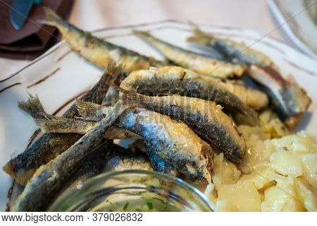 Grilled Sardines On A Plate In A Restaurant