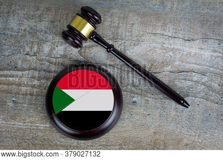 Wooden Judgement Or Auction Mallet With Of Sudan Flag. Conceptual Image.