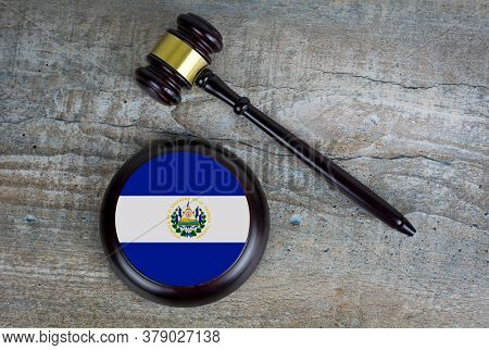 Wooden Judgement Or Auction Mallet With Of Salvador Flag. Conceptual Image.