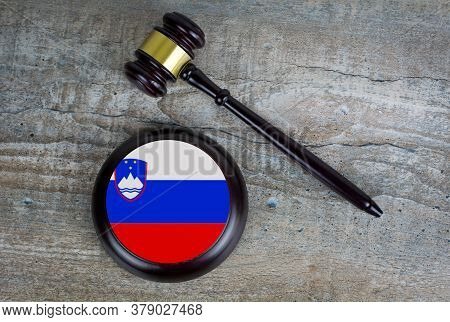 Wooden Judgement Or Auction Mallet With Of Slovenia Flag. Conceptual Image.