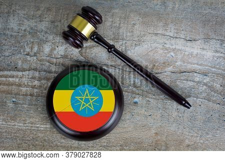 Wooden Judgement Or Auction Mallet With Of Ethiopia Flag. Conceptual Image.
