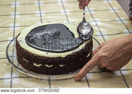 Homemade Chocolate Cake. Cooking The Cake. Decorating The Cake With Chocolate. Smear Liquid Chocolat