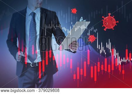 Businessman Looking At Report With Double Exposure Of Blurry Falling Graphs And Coronavirus. Toned I