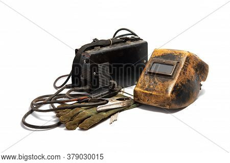 Welding Mask With Welding Machine, Protective Gloves, And Arc Steel Electrodes. Kit Of Used Welding