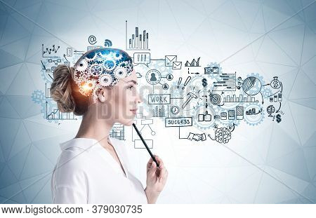 Side View Of Thoughtful Young Businesswoman With Pencil Standing Near Gray Wall With Brain Sketch An
