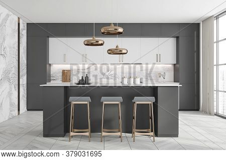 Front View Of Stylish Kitchen With Gray And Marble Walls, White Cupboards And Countertops And Bar Wi