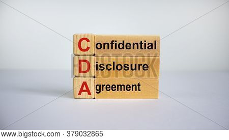 Concept Words 'cda, Confidential Disclosure Agreement' On Cubes On A Beautiful Blue Background. Busi