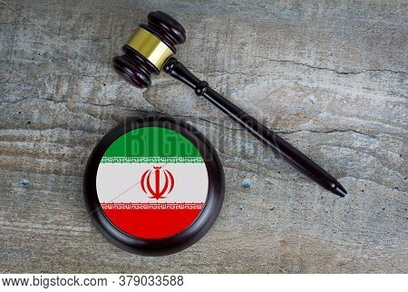 Wooden Judgement Or Auction Mallet With Of Iran Flag. Conceptual Image.