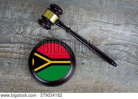 Wooden Judgement Or Auction Mallet With Of Vanuatu Flag. Conceptual Image.
