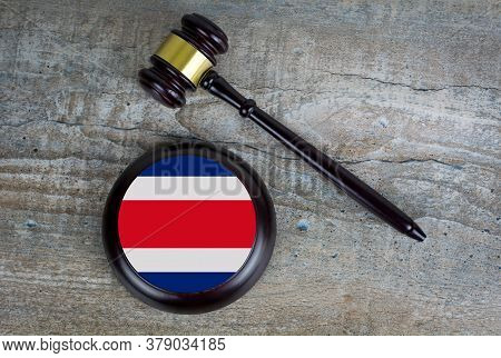 Wooden Judgement Or Auction Mallet With Of Costa Rica Flag. Conceptual Image.