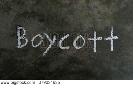 Boycott Word Written On Blackboard With White Chalk