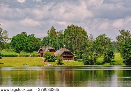 Two Houses On The Bank Of The River
