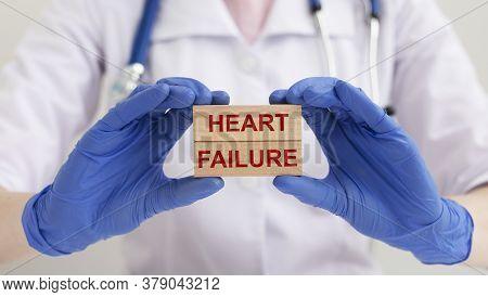 Heart Failure Concept. Heart Failure Words Inscription On Wooden Blocks In Doctor Hands