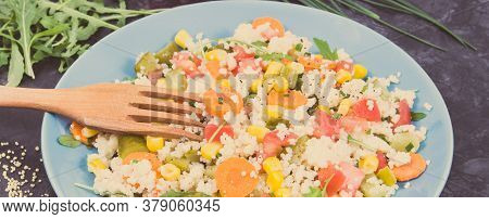 Fresh Salad With Vegetables And Couscous Groats. Light And Healthy Meal Containing Natural Vitamins