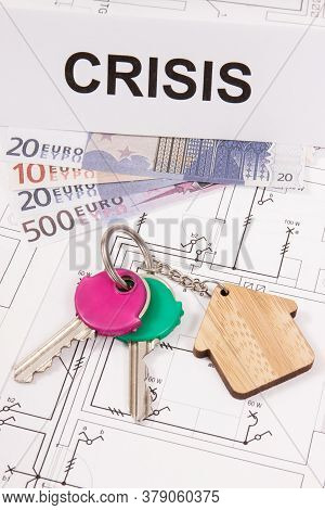 Keys With Home Shape, Currencies Euro And Inscription Crisis On Electrical Construction Diagrams Of