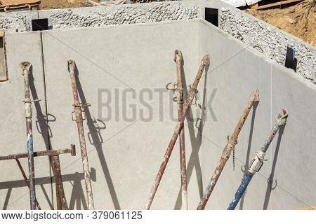 Many Construction Supports At A Waterproof Cellar Wall