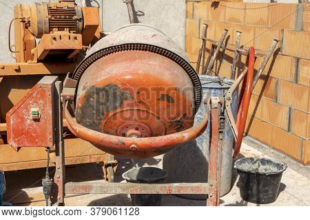 Concrete Mixer At A Construction Site In The Cellar