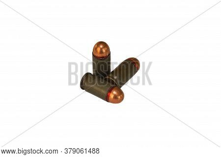 Three 9mm Caliber Combat Pistol Cartridges For Makarov Pistol On White Isolated Background Side View