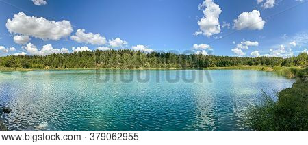 Idyllic Turquoise Colored Quarry Lake In Forest. Panoramic Summer Landscape