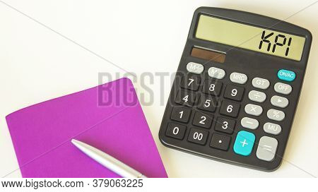 Kpi Text On Calculator, Pen And Notepad On White Background. Goal Concept.